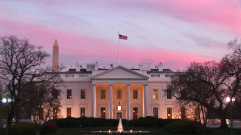 Pale pink and blue streaks form a colorful backdrop behind the White House Footage