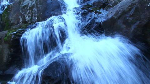 A mountain stream cascades over rocks Footage