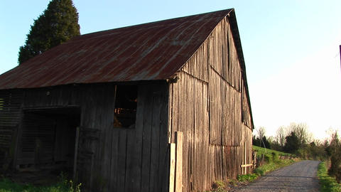 Sunlight rejuvenates aged timbers of an old abandoned... Stock Video Footage