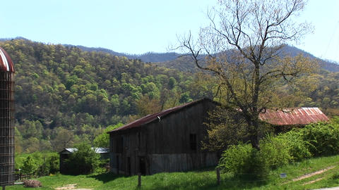 A country house and barn sit surrounded by beautiful... Stock Video Footage