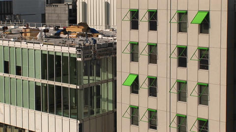 Zoom-in to a green awning on a tall building in Atlanta, Georgia Footage