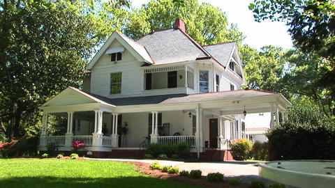 Beautiful landscaping and trees surround this two-story... Stock Video Footage