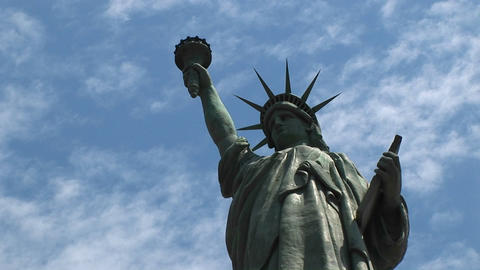 The Statue of Liberty proudly stands silhouetted against... Stock Video Footage