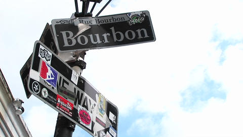 Even bent and bullet-ridden, this sign for Bourbon Street still identifies the famous New Orleans la Footage