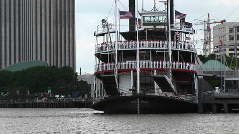 The Mississippi River flows around a paddleboat full of... Stock Video Footage