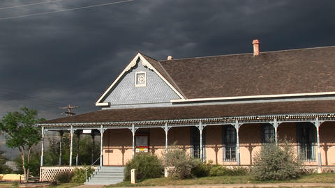Medium-shot of a ranch house with storm clouds building... Stock Video Footage