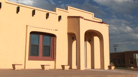 Medium-shot of the entrance to an Adobe building Footage
