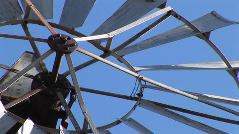Close-up of the blades of a windmill spinning Stock Video Footage