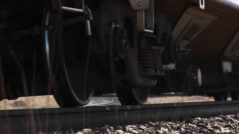 A freight train passes from a low angle Footage