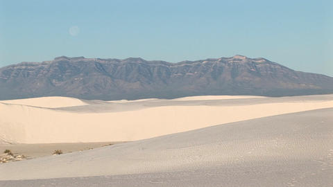 Long-shot of mountains and sand dunes at White Sands National Monument in New Mexico Footage