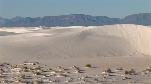 Pan-left of distant mountains and sand dunes at White Sands National Monument in New Mexico Footage