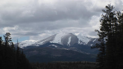 Zoom-in on a snowy mountain peak in the Sierra Blanca... Stock Video Footage