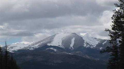 Zoom-in on a snowy mountain peak in the Sierra Blanca Mountain Range in New Mexico Footage
