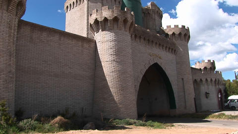 Pan-up of the front gate of a medieval castle Stock Video Footage