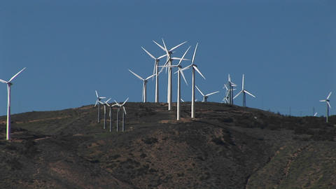 Long-shot of wind turbines generating power at Tehachapi, California Footage