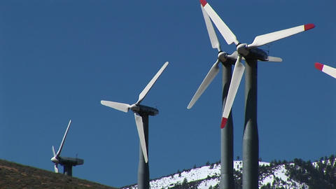 Medium-shot of four wind turbines generating power at Tehachapi, California Footage