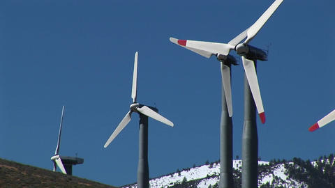 Medium-shot of four wind turbines generating power at... Stock Video Footage