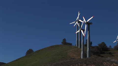 Long-shot of four turbines generating power at Tehachapi,... Stock Video Footage