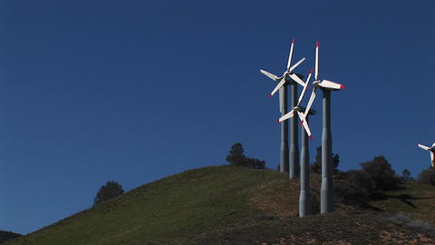 Long-shot of four turbines generating power at Tehachapi, California Footage