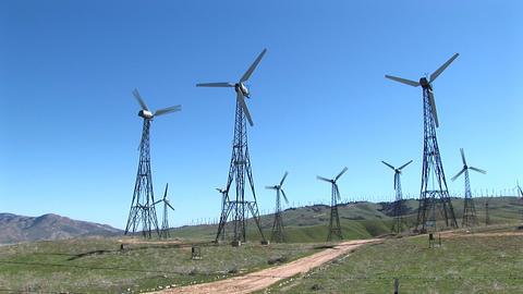 Long-shot of several wind turbines generating power at... Stock Video Footage