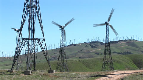 Medium shot of four wind turbines generating power at... Stock Video Footage