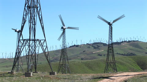 Medium shot of four wind turbines generating power at Tehachapi, California Footage