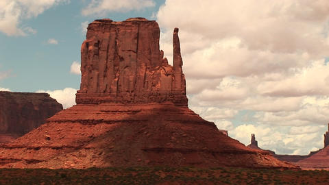 Medium-shot of the Mittens formation at Monument Valley Tribal Park in Arizona and Utah Footage