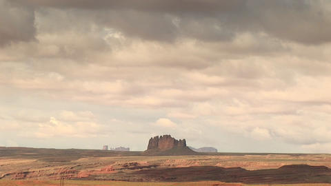 Long-shot of a sandstone formation and surrounding landscape at Monument Valley Tribal Park in Arizo Footage