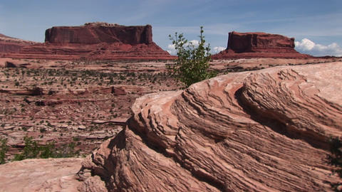 Long-shot of two sandstone formations at Monument Valley Tribal Park in Arizona and Utah Footage