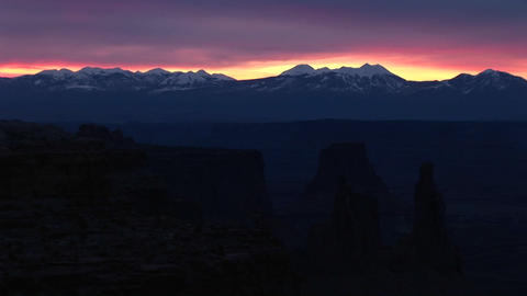 Long shot of snow-capped La Sal Mountains in Canyonlands... Stock Video Footage