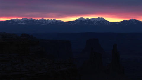 Long shot of snow-capped La Sal Mountains in Canyonlands National Park at golden-hour Footage