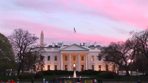 Medium shot of people walking by the White House at golden hour Footage