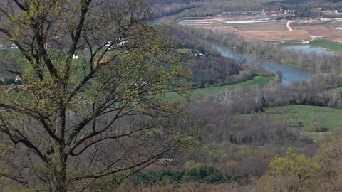 Long shot of a river flowing through a valley in the Blue Ridge Mountains Footage