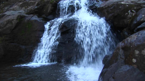 Pan up shot of a waterfall in the Blue Ridge Mountains Stock Video Footage