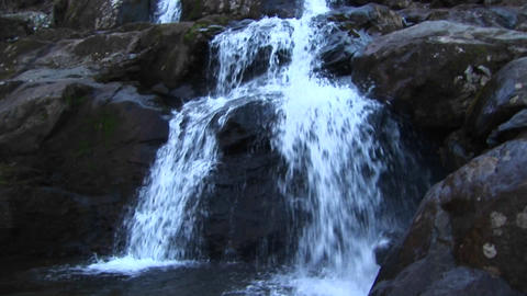 Pan up shot of a waterfall in the Blue Ridge Mountains Footage