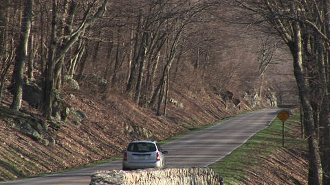 Medium shot of a car driving down the Blue Ridge Highway Stock Video Footage