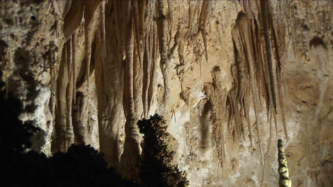 Medium shot of the inside of a cave at Carlsbad Caverns National Park in New Mexico Footage