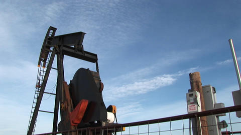 Medium-shot of an oil pump turning in the New Mexico desert Stock Video Footage