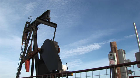Medium-shot of an oil pump turning in the New Mexico desert Footage