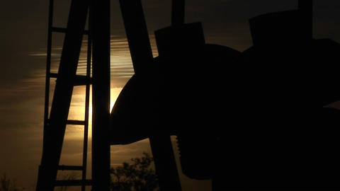 Close-up of a silhouetted oil pump turning in the New... Stock Video Footage