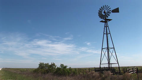 Medium shot of a windmill turning in the breeze Stock Video Footage