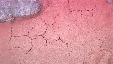 Close-up of cracks in red Arizona desert mud Footage