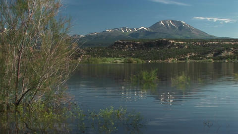 Medium-shot of the Recapture Lake in Utah and the San Juan Mountain Footage