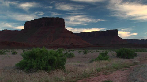 Long shot of Castle Rock standing in the Utah desert near Moab Footage