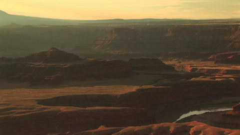 Long shot of the Colorado River snaking through Canyonlands National Park from the Dead Horse Point Footage