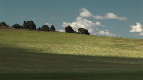 Medium shot of wind blowing across grassy hills outside Zion National Park in Utah Footage