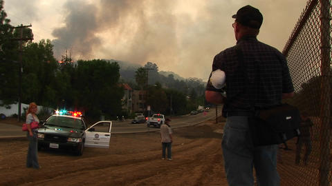 Medium shot of emergency personnel viewing a wildfire... Stock Video Footage