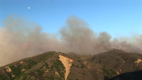 Long shot of the wind carrying smoke from wildfires... Stock Video Footage