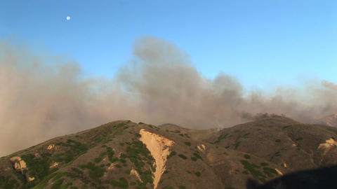 Long shot of the wind carrying smoke from wildfires burning in southern California Footage