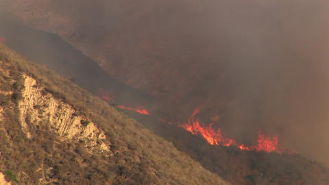 Long shot of wildfires burning on a hillside in southern California Footage